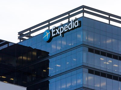 Expedia cuts about 3,000 jobs